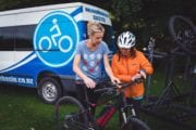 Guide Lisa setting up a client with an electric bike
